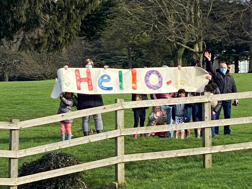 Pupils from Abbot's Hill School head down the hill to say a socially distanced '