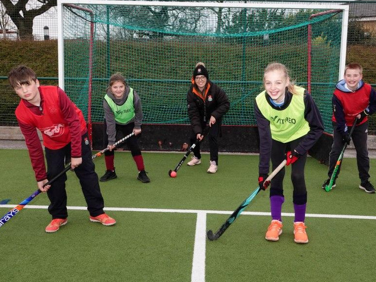 Ashville Head of Hockey, Laura Thompson, with some of the Easter Sports Camp participants