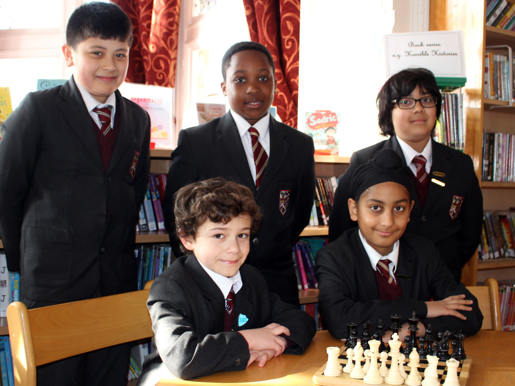 Brentwood Prep Online Chess - left-right (standing) Max Jaden Yahya (sitting) Markos Dilsher Year 6 Bubble