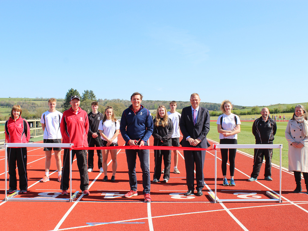Roger Black MBE with Mark Lascelles, Head Master, Dauntsey's and members of staff and pupils from Dauntsey's at the opening of the new running track
