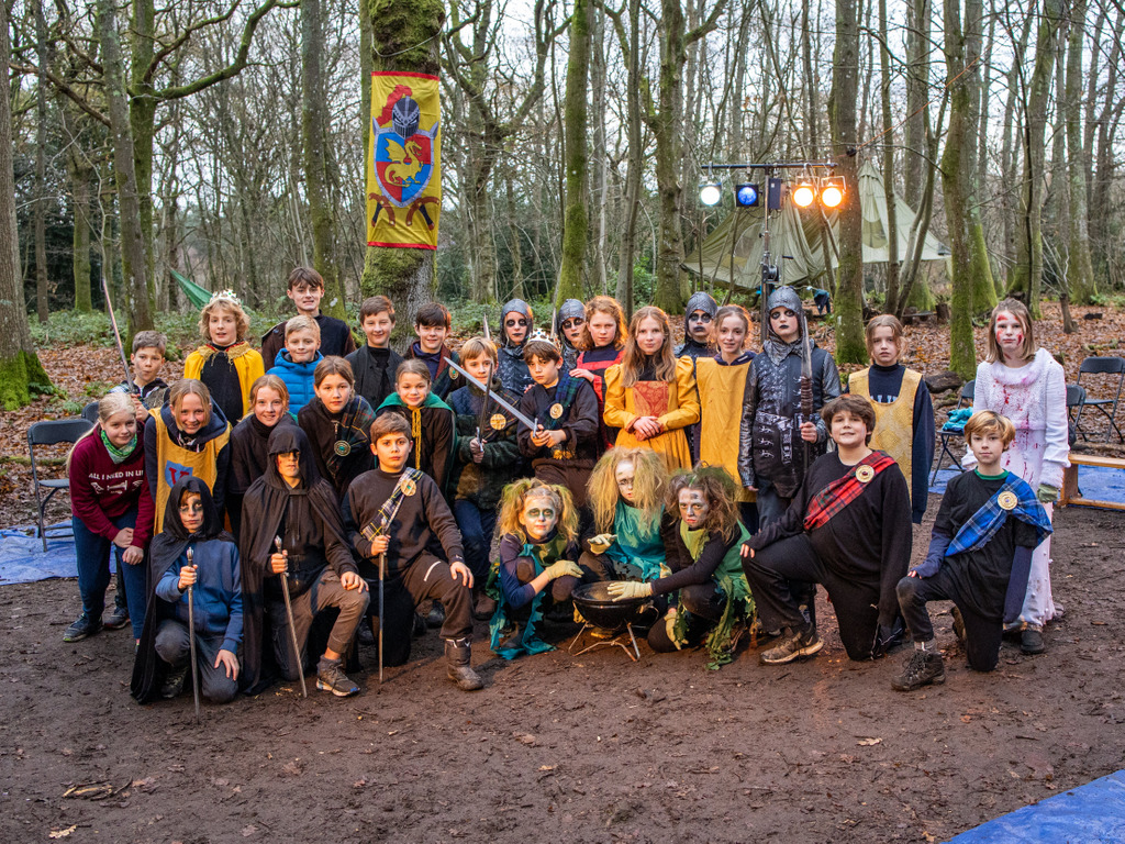 Year 7 at Highfield and Brookham Schools perform Macbeth in their woods.
