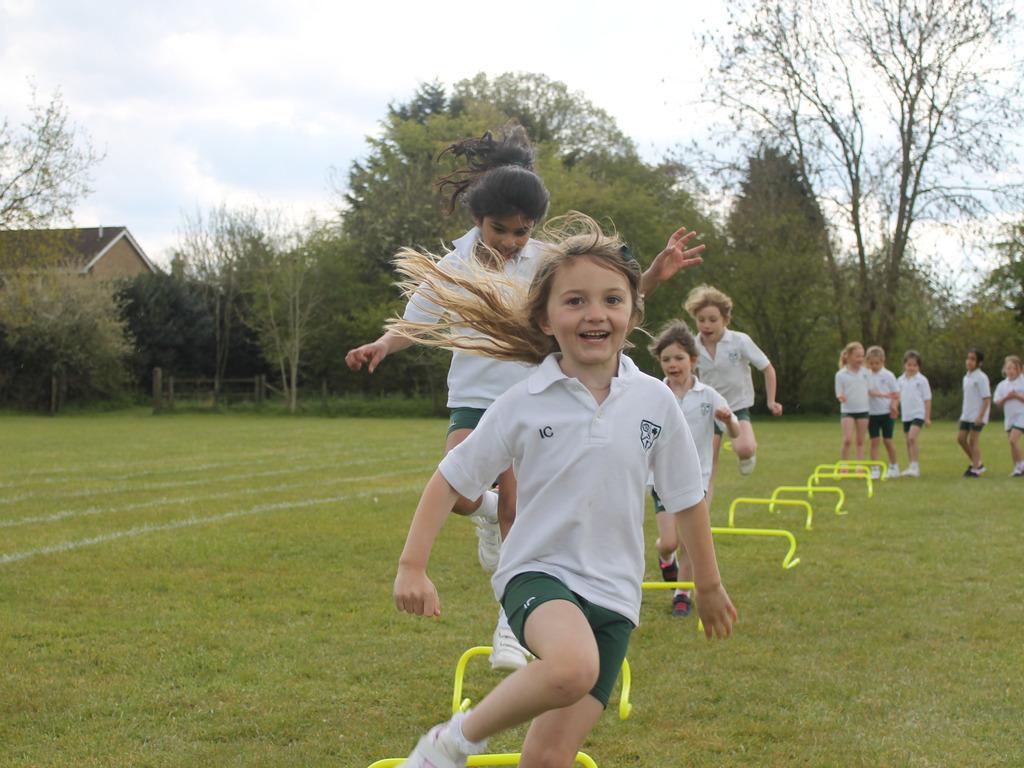Pre-Prep enjoying their hurdle challenge.
