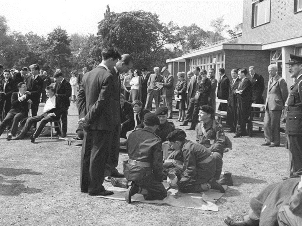 Prince Philip chattng with CCF Cadets on a visit to The Leys