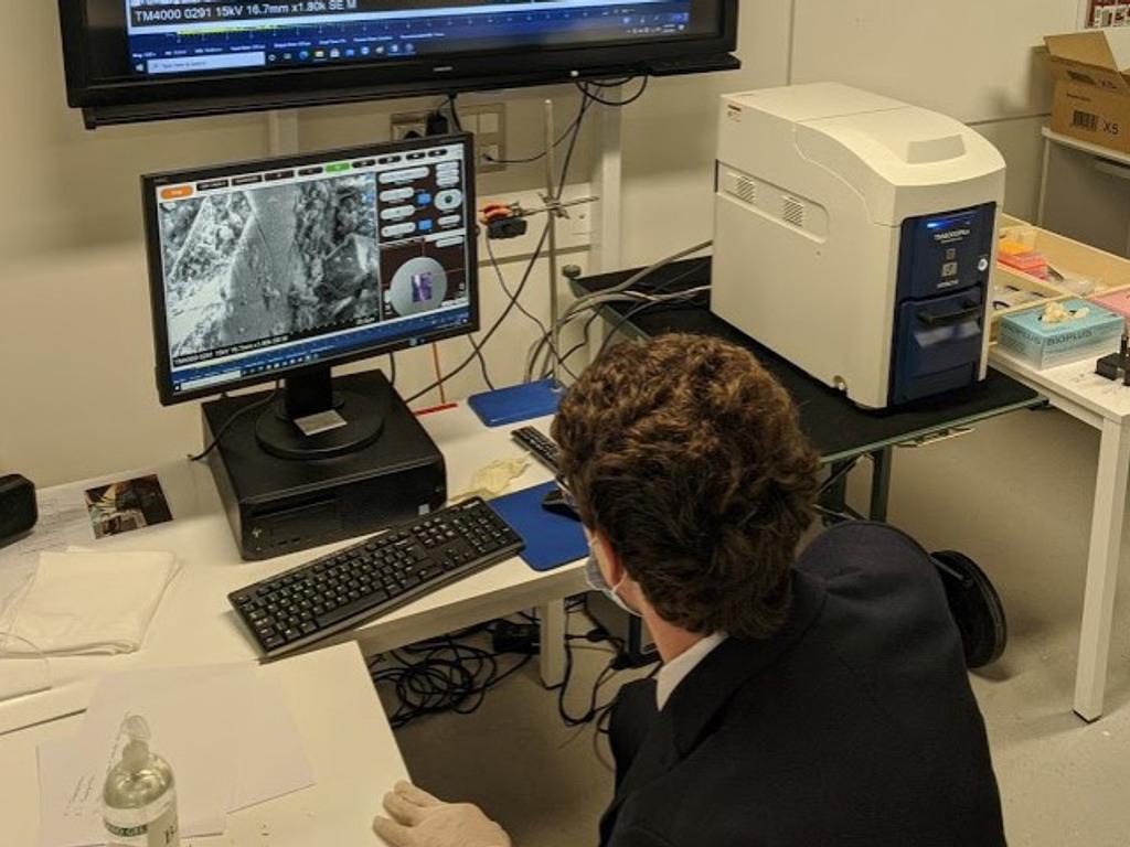 Boy using Scanning Electron Microsope CROP 1