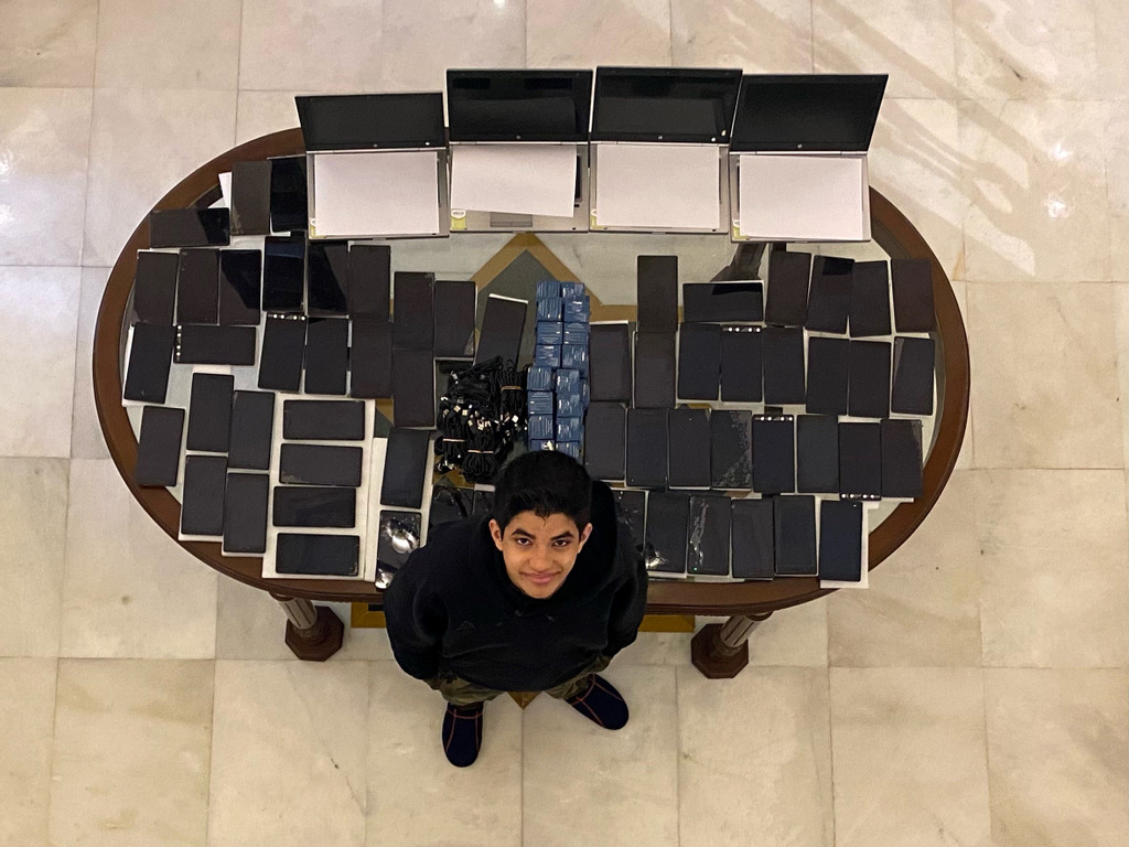 Ishan Kapur with the digital devices he collected